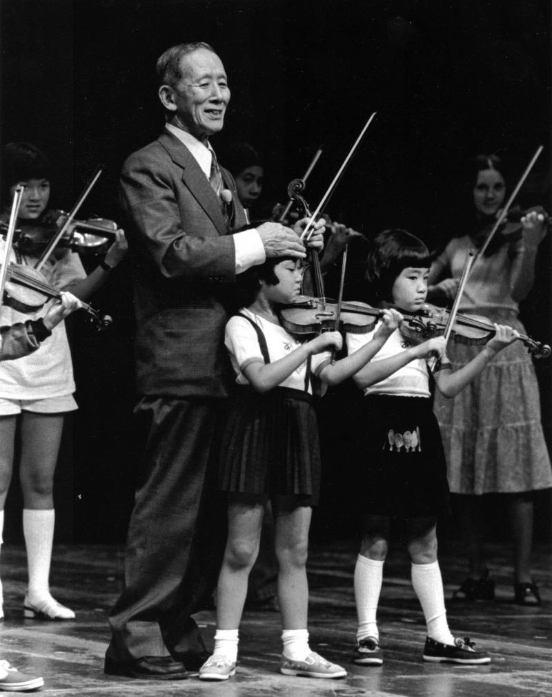 Dr. Suzuki on Stage with Students, circa 1971.